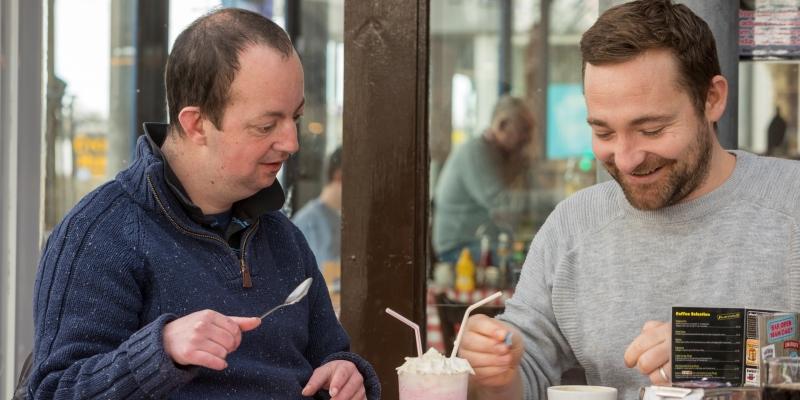Photo of people enjoying a milkshake